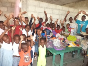 Children receiving Barrel of clothing, toys and goodies